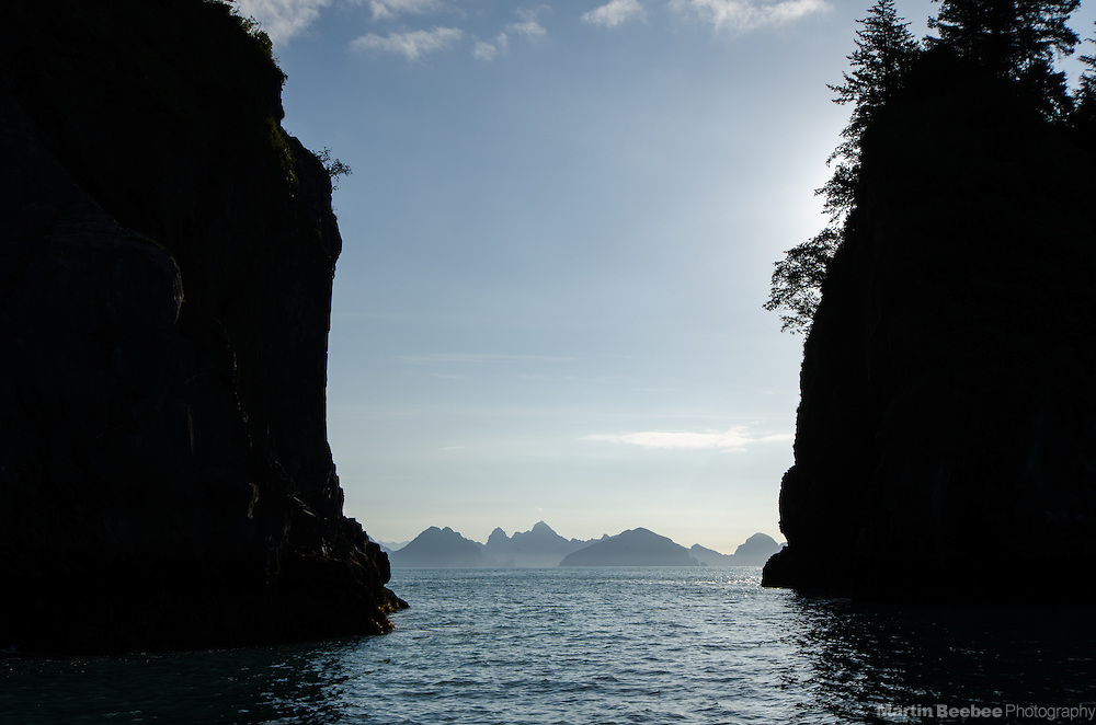 Silhouetted sea stacks and mountains, Kenai Fjords National Park, Alaska