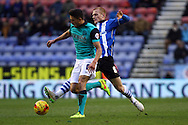 Ben Watson of Wigan Athletic looks to tackle Jason Lowe of Blackburn Rovers. Skybet football league championship match , Wigan Athletic v Blackburn Rovers at the DW Stadium in Wigan, Lancs on Saturday 17th Jan 2015.<br /> pic by Chris Stading, Andrew Orchard sports photography.