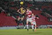 JJ Hooper (Port Vale) and Conor Grant (Doncaster Rovers) jump for the ball during the Sky Bet League 1 match between Doncaster Rovers and Port Vale at the Keepmoat Stadium, Doncaster, England on 26 January 2016. Photo by Mark P Doherty.