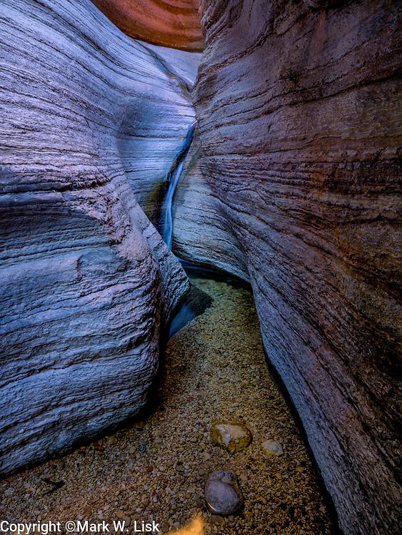 Water cuts through a Muav Limestone shelf forming a beautiful waterfall in National Canyon, Grand Canyon National Park.