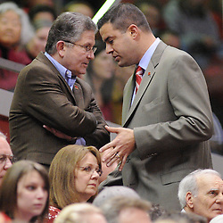 Mar 2, 2009; Piscataway, NJ, USA; Rutgers President Richard McCormick meets with new Athletic Director Tim Pernetti during the first half of Rutgers game against nationally rated #1 Connecticut at the Louis Brown Athletic Center. Connecticut won 69-59 to finish their regular season a perfect 30-0.
