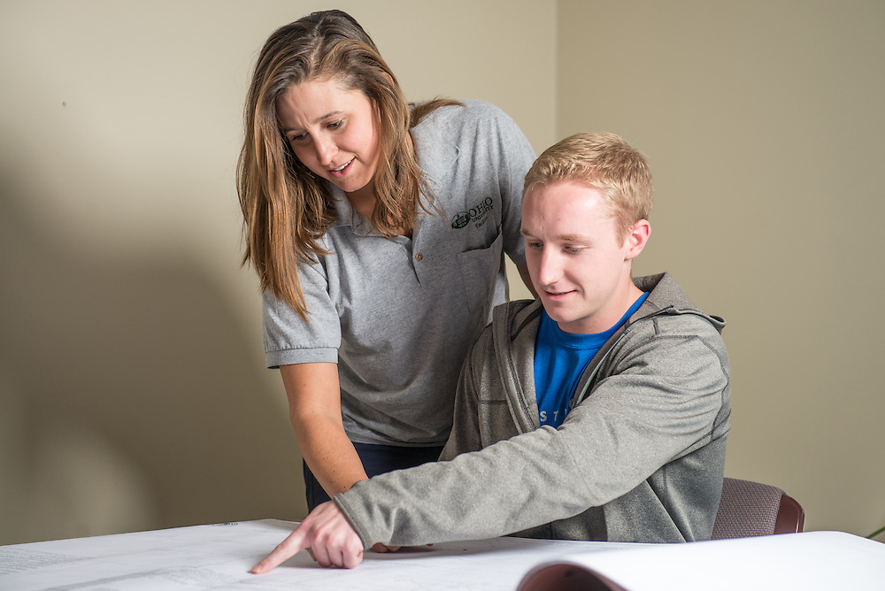 Ohio University Energy Engineering major, Jacob Colbrunn, looks over plans with his senior design project client, Claire Naisby, at the University Service Center on November 15, 2016.