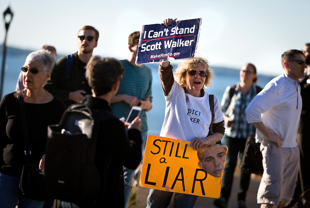 MADISON, WI — SEPTEMBER 21: Christine Taylor, right, celebrates the end of Governor Scott Walker's Presidential campaign outside the Edgewater Hotel, Monday, September 21, 2015.