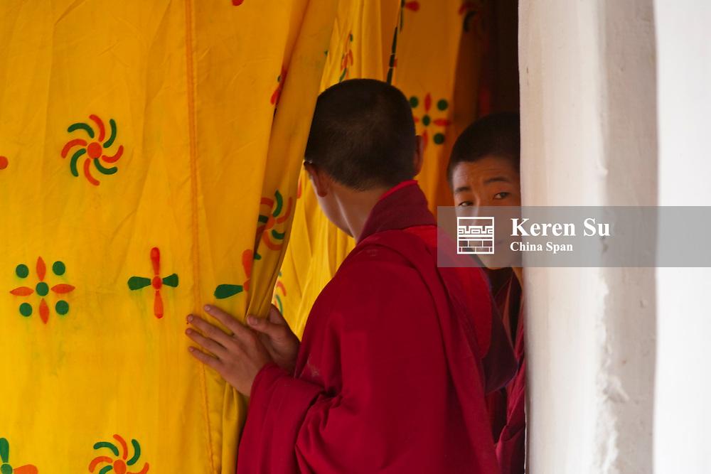 A monk behind curtain at Blessing Festival, Punakha Dzong, Punakha, Bhutan