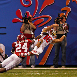 2 January 2009: Utah wide receiver David Reed (16) makes an acrobatic catch over Alabama cornerback Marquis Johnson (24) and lunges into the endzone to complete a 30-yard touchdown during the 75th annual All State Sugar Bowl  between the Utah Utes and the Alabama Crimson Tide at the Louisiana Superdome in New Orleans, LA.