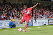 York City defender Marvin McCoy crosses the ball into the box during the Sky Bet League 2 match between York City and Mansfield Town at Bootham Crescent, York, England on 29 August 2015. Photo by Simon Davies.