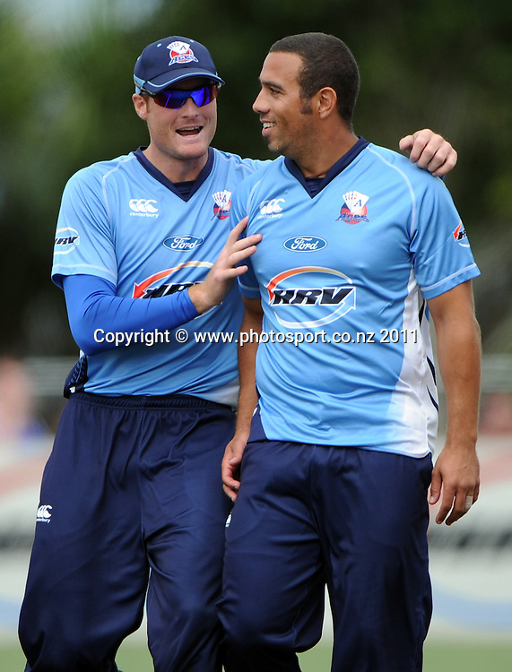 Martin Guptill and Andre Adams during the HRV Twenty20 Cricket Final between the Auckland Aces and Canterbury Wizards at Colin Maiden Oval in Auckland, New Zealand on Sunday 22 January 2012. Photo: Andrew Cornaga/Photosport.co.nz
