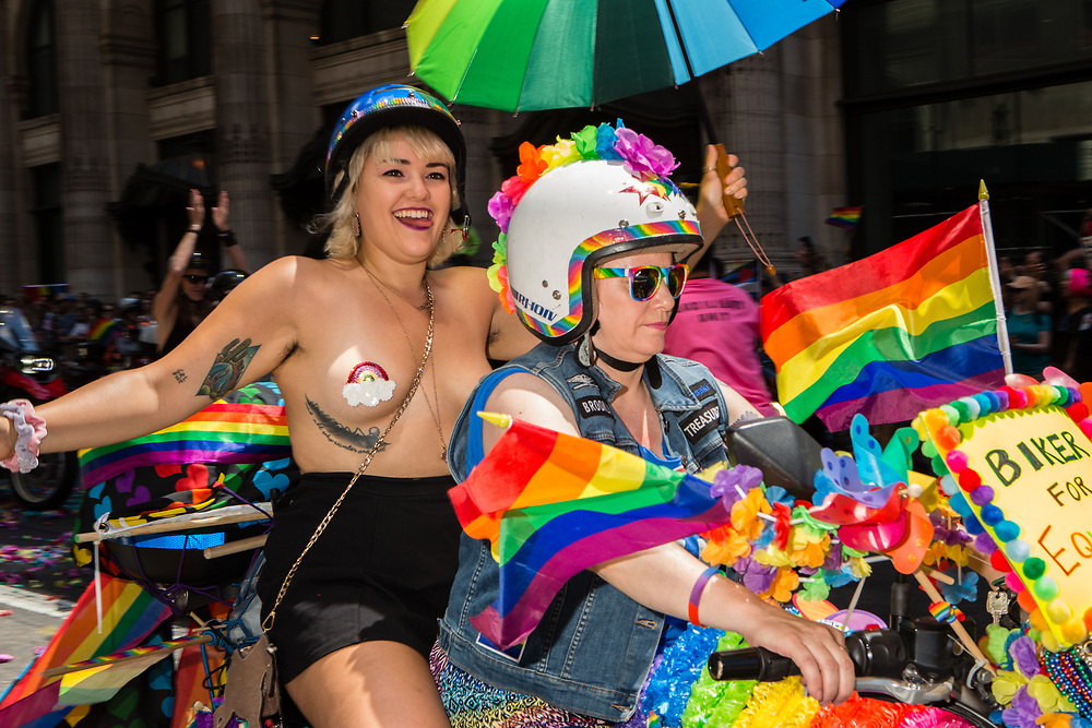 New York, NY - 25 June 2017. New York City Heritage of Pride March filled Fifth Avenue for hours with groups from the LGBT community and it's supporters. Two women from the Sirens Motorcycle Club on a bike at the start of the march.
