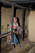 Young girl from Ngiresi Village close to Arusha inside her hut.