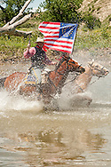 Major Reno portrayed by Keith Herrin crosses Little Bighorn River, Battle of the Little Bighorn Reenactment,<br />