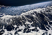 "Deep bow wave, recalling Homer's ""wine dark sea"" as it forms an abstract foamy diagonal."