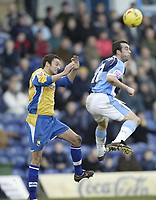 Photo: Aidan Ellis.<br /> Mansfield Town v Wycombe Wanderers. Coca Cola League 2. 24/02/2007.<br /> Wycombe's Scott McGleish flicks the ball on with his head in front of Mansfield's Gareth Jelleyman
