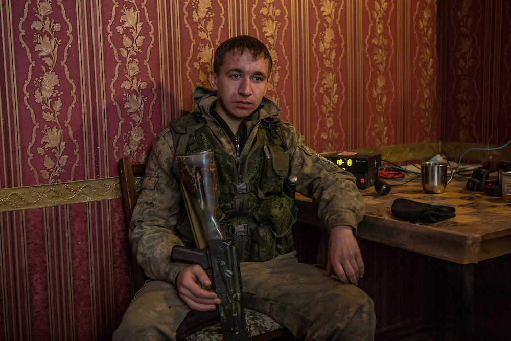 GORLOVKA, UKRAINE - JANUARY 31, 2015: A rebel fighter relaxes inside a house in which they live behind a front-line position in Gorlovka, Ukraine. Fighting in Ukraine has intensified over the last week, with rebels declaring the end of a September ceasefire. CREDIT: Brendan Hoffman for The New York Times