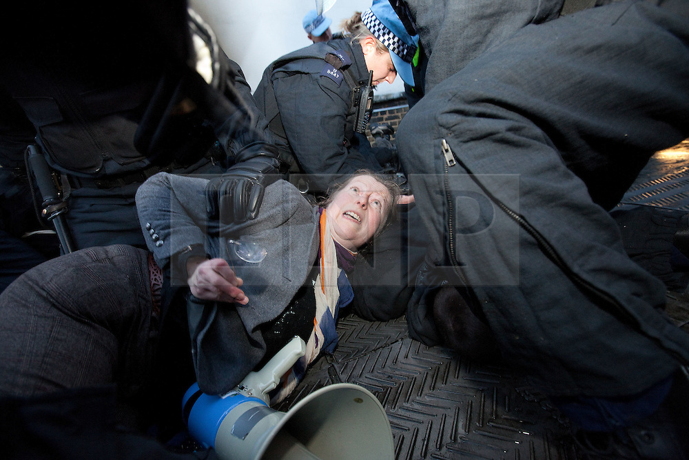 """© Licensed to London News Pictures. 30/11/2011. London, UK. """"Occupy"""" protesters get on to the roof of Panton House in Haymarket. They hung a banner from the roof before police came up and arrented several for Criminal Trespass. Photo credit : Joel Goodman/LNP"""