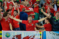 LILLE, FRANCE - Friday, July 1, 2016: Wales supporters celebrate the second goal against Belgium during the UEFA Euro 2016 Championship Quarter-Final match at the Stade Pierre Mauroy. (Pic by David Rawcliffe/Propaganda)
