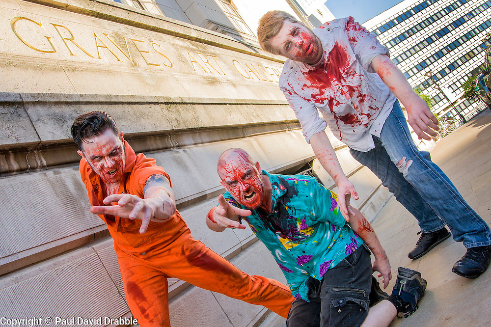 Slingshots Top Zombies Alex Noble, Noel Davies-Atack and Paul Byrne outside Graves Art Gallery Sheffield on Tuesday evening ahead of the game 2.8 Hours Later which reaches the city in August <br /> <br /> 30 June 2015<br />  Image &copy; Paul David Drabble <br />  www.pauldaviddrabble.co.uk