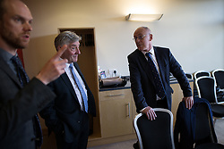 © Licensed to London News Pictures . 29/05/2015 . Leigh , UK . Sir Richard Leese (r) announces Tony Lloyd (c) as interim Mayor of Greater Manchester in what is the UK's first devolved Mayorilty with such power , outside of London . Photo credit : Joel Goodman/LNP