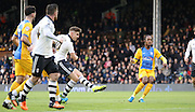Tom Cairney strikes during the Sky Bet Championship match between Fulham and Preston North End at Craven Cottage, London, England on 28 November 2015. Photo by Pete Burns.