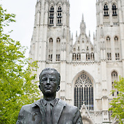 A statue of King Baudouin of Belgium (reigned 1951-1993) at the Cathedral of St. Michael and St. Gudula (in French, Co-Cathédrale collégiale des Ss-Michel et Gudule). A church was founded on this site in the 11th century but the current building dates to the 13th to 15th centuries. The Roman Catholic cathedral is the venue for many state functions such as coronations, royal weddings, and state funerals. It has two patron saints, St Michael and St Gudula, both of whom are also the patron saints of Brussels.