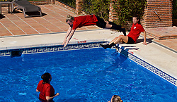 ALHAURÍN EL GRANDE, SPAIN - Tuesday, February 26, 2019: Wales' Kylie Nolan jumps into the water of the hotel swimming pool during a training session at the at Alhaurin Golf Resort in Spain. (Pic by David Rawcliffe/Propaganda)