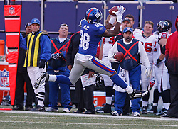 Nov 22, 2009; East Rutherford, NJ, USA; New York Giants wide receiver Hakeem Nicks (88) catches a pass from New York Giants quarterback Eli Manning (10) during the first half of their game against the Atlanta Falcons at Giants Stadium. Mandatory Credit: Ed Mulholland