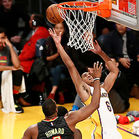 27 November 2016: Los Angeles Lakers guard Jordan Clarkson (6) goes for the layup over Atlanta Hawks center Dwight Howard (8) during the Los Angeles Lakers 109-94 victory over the Atlanta Hawks, at the Staples Center, Los Angeles, California, USA.