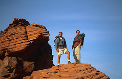 two hikers on top of a rock formation in Nevada, hiking boots, outdoors, outdoor life, the great outdoors