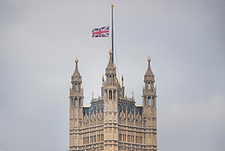 © Licensed to London News Pictures.23/03/2017.London, UK. The Union flag flies at half mast on Victoria Tower as Prime Minister Theresa May speaks to Parliament, the day after a lone terrorist killed 4 people and injured several more, in an attack using a car and a knife. The attacker managed to gain entry to the grounds of the Houses of Parliament, killing one police officer.Photo credit: Peter Macdiarmid/LNP