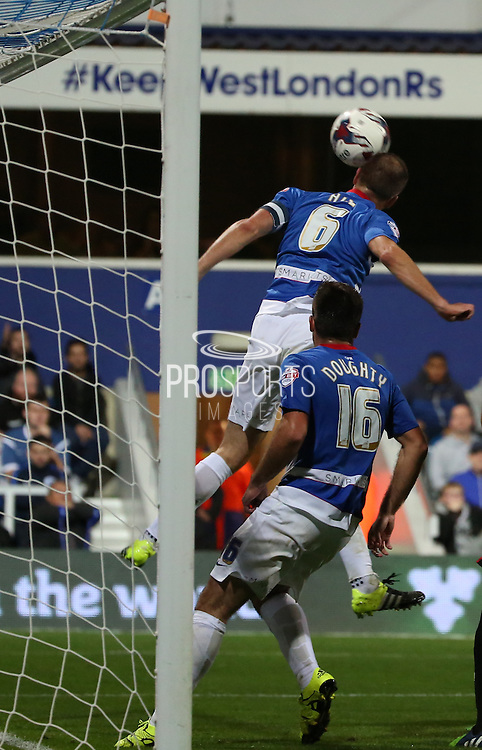 Clint Hill (QPR defender) clearing off the line from a Carlisle United chance during the Capital One Cup match between Queens Park Rangers and Carlisle United at the Loftus Road Stadium, London, England on 25 August 2015. Photo by Matthew Redman.