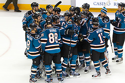 Jan 17, 2012; San Jose, CA, USA; San Jose Sharks defenseman Brent Burns (88) is congratulated by teammates after scoring a goal against the Calgary Flames during shootouts at HP Pavilion. San Jose defeated Calgary 2-1 in shootouts. Mandatory Credit: Jason O. Watson-US PRESSWIRE