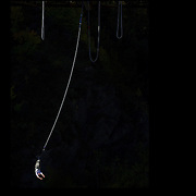 A bungy jumper in action from The AJ Hackett Kawarau Bridge Bungy Jump, Queenstown New Zealand. The Kawarau Bridge Bungy jump was the World's first Commercial bungy Jump and opened in 1988. The 43m jump attracts tens of thousands of bungy jumpers each year. Queenstown, Central Otago, South Island, New Zealand. 30th March 2011. Photo Tim Clayton..