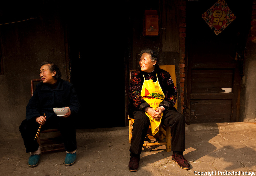 Two ladies hang out in an alley in Chengdu