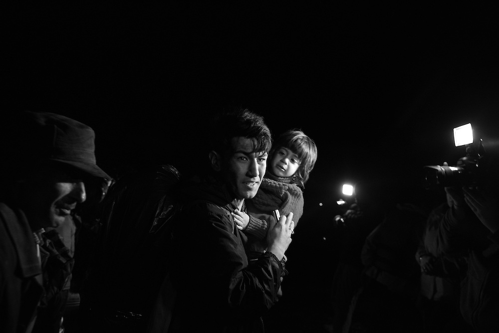 Migrants and refugees arrive on the Greek island of Lesbos after crossing the Aegean Sea from Turkey. European leaders tried to focus on joint action with Africa to tackle the refugee crisis, as Slovenia became the latest EU member to act on its own by barricading its border. (Photo by Lori Hawkins)