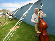 As the fair winds down after an eventful week, Mark Memmer warms up before taking the stage at the Teton County Fair fiddle contest Sunday morning.