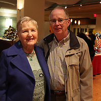 Estelle Bromilow, left, and Neil Bromilow pose for a photo Friday November 28, 2014 during the Atlantic Marine Holiday Flotilla Launch Party. (Jason A. Frizzelle)