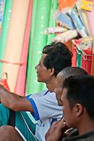 Three men at the market on Nusa Penida, Bali, Indonesia