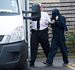 © London News Pictures. 16/12/2013 . Oxford, UK. BEN BLAKELEY (right) being led to a prison van in handcuffs after appearing at Oxford Magistrates Court, charged with the murder of missing teenager Jayden Parkinson.  Photo credit : Ben Cawthra/LNP