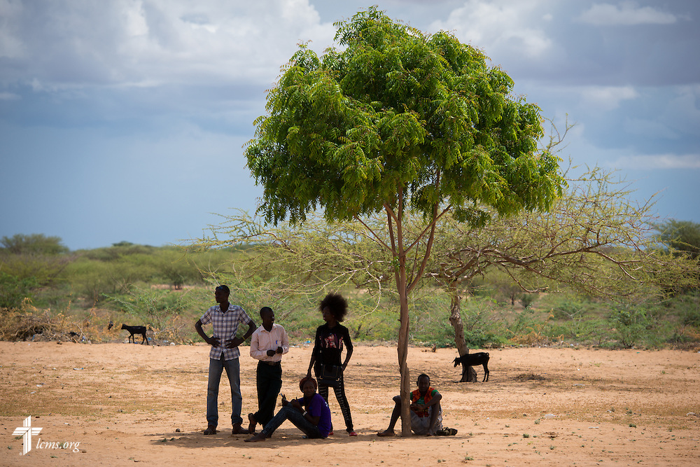 Kenyan medical workers take refuge in the shade during break at the LCMS Mercy Medical Team clinic on Monday, June 20, 2016, in Nataparkakono, a village in Turkana, Kenya.  LCMS Communications/Erik M. Lunsford