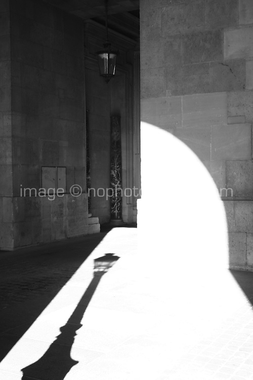 Sunlight and shadow under a archway at the Louvre, Paris, France<br />