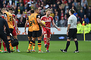 Adam Clayton of Middlesbrough FC remonstrates with ref after giving foul away during the Sky Bet Championship match between Hull City and Middlesbrough at the KC Stadium, Kingston upon Hull, England on 7 November 2015. Photo by Ian Lyall.