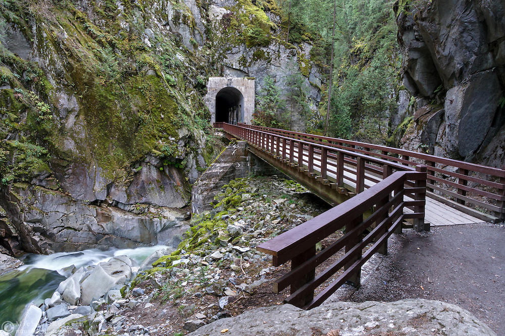 Bridge over the Coquihalla River and one of the Othello Tunnels in Coquihalla Canyon Provincial Park near Hope, British Columbia, Canada.  These paths and tunnels were part of the Kettle Valley Railway which ran from Hope to Midway in British Columbia. The tunnels and railway were constructed in 1914 and are also known as the Quintette tunnels.
