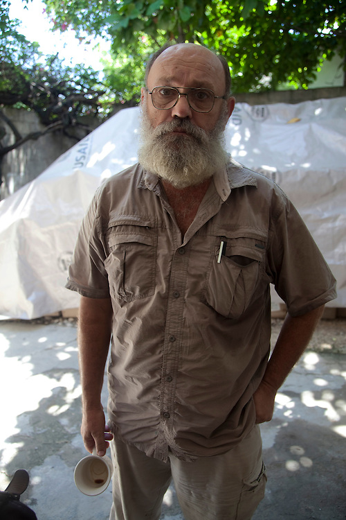 John Cindric, Camp Manager of the makeshift refugee camp, La Piste, in Port-au-Prince, Haiti on July 21, 2010. The camp is estimated to have over 50,000 refugees. <br /> Six month after a catastrophic earthquake measuring 7.3 on the Richter scale hit Haiti on January 13, 2010, killing an estimated 230,000 people, injuring an estimated 300,000 and making homeless an estimated 1,000,000.