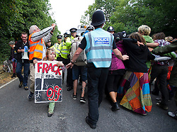 © London News Pictures. 17/08/2013. Balcombe, UK. Campaigners attempt to stop a lorry gentering the Cuadrilla drilling site in Balcombe, West Sussex which has been earmarked for fracking. Cuadrilla has temporarily ceased drilling at the site under advice from the police after campaign group No Dash For Gas threatened a weekend of civil disobedience. Photo credit: Ben Cawthra/LNP