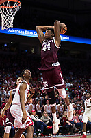 FAYETTEVILLE, AR - FEBRUARY 17:  Robert Williams #44 of the Texas A&M Aggies goes up for a dunk during a game against the Arkansas Razorbacks at Bud Walton Arena on February 17, 2018 in Fayetteville, Arkansas.  The Razorbacks defeated the Aggies 94-75.  (Photo by Wesley Hitt/Getty Images) *** Local Caption *** Robert Williams