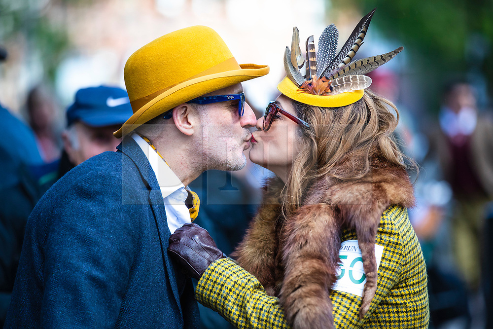 © Licensed to London News Pictures. 04/05/2019. London, UK. A couple share a kiss at the start of the annual Tweed Run bicycle ride, in which participants cycle around the capital wearing vintage tweed outfits. Photo credit: Rob Pinney/LNP