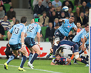 Wyclif Palu (Waratahs) sends a diving offload pass during the Round 15 match of the 2013 Super Rugby Championship between RaboDirect Rebels vs HSBC Waratahs at AAMI Park, Melbourne, Victoria, Australia. 24/05/0213. Photo By Lucas Wroe