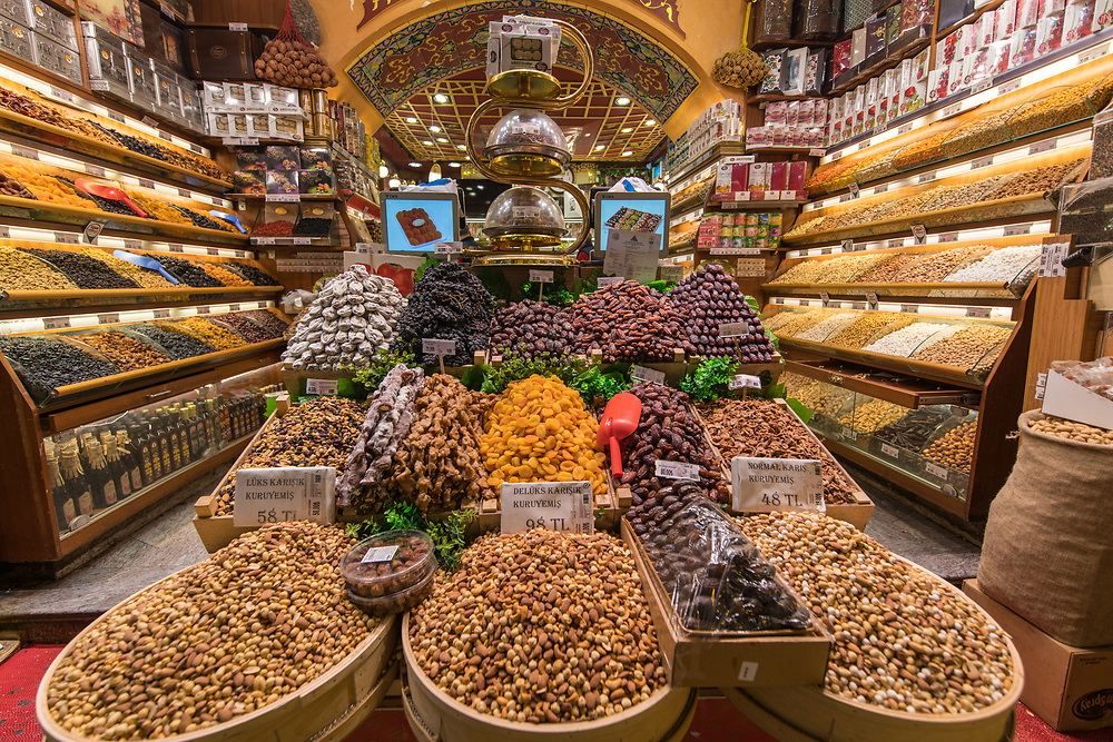 Storefront display showcases an array of dried fruits, nuts and other goods at Istanbul Spice bazaar in Turkey
