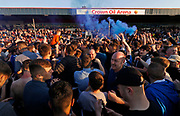 Happy Rochdale players and fans with flares celebrating their escape from relegation during the EFL Sky Bet League 1 match between Rochdale and Charlton Athletic at Spotland, Rochdale, England on 5 May 2018. Picture by Paul Thompson.