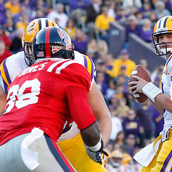 November 17, 2012; Baton Rouge, LA, USA;  LSU Tigers quarterback Zach Mettenberger (8) looks to throw against the Ole Miss Rebels during the first half of a game at Tiger Stadium.  Mandatory Credit: Derick E. Hingle-US PRESSWIRE