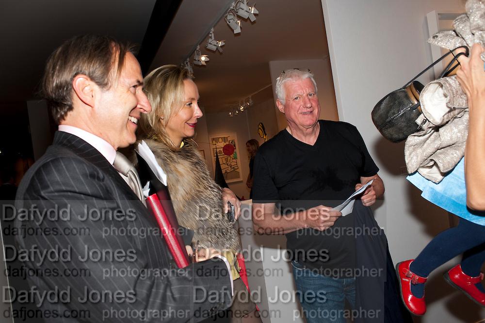 SIMON DE PURY; MICHAELA DE PURY;  DR FRIEDRICH-CHRISTIAN FLICK, Pavilion of art and design.- PAD London  Berkeley Square. London. 10 October 2011. <br /> <br />  , -DO NOT ARCHIVE-© Copyright Photograph by Dafydd Jones. 248 Clapham Rd. London SW9 0PZ. Tel 0207 820 0771. www.dafjones.com.